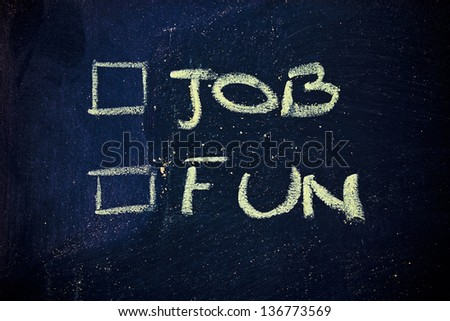 chalk writings on blackboard, is your job or your fun time a priority? - stock photo