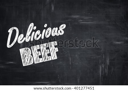 Chalkboard background with chalk letters: Delicious beef sign