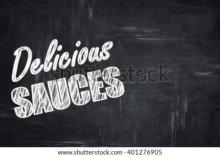 Chalkboard background with chalk letters: Delicious sauces sign