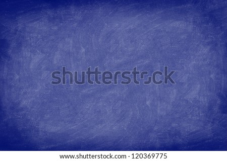 Chalkboard / dark blue blackboard texture background. Used feel, textured with chalk traces. Photo. - stock photo