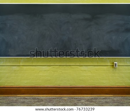 Chalkboard in a newly renovated college classroom - stock photo