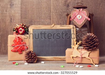 Chalkboard mock up with Christmas gifts and rustic decorations - stock photo