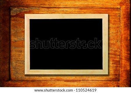 chalkboard on grunge wooden background