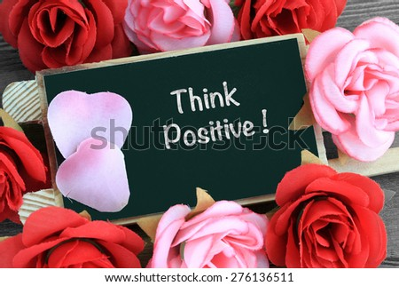 chalkboard sign showing the message of think positive - stock photo