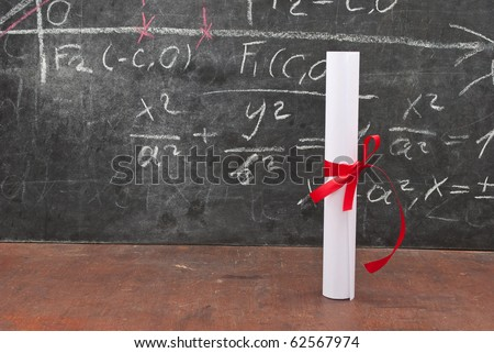 Chalkboard with a diploma - stock photo
