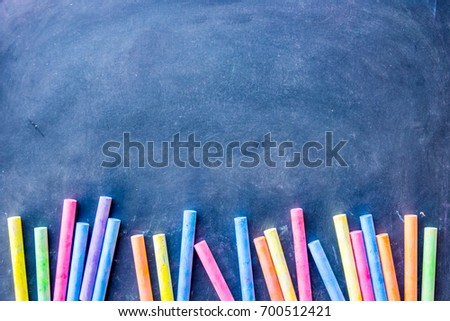 Chalkboard with colorful chalk background. Concept for education, advertising and business. Black chalkboard.