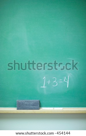 Chalkboard with equation, eraser, and chalk (14MP camera) - stock photo