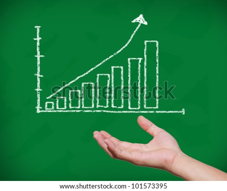 chalkboard with hand and trend chart: path for drawing available in file - stock photo
