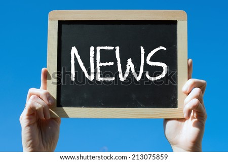 Chalkboard with Hands with text news - stock photo