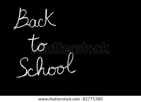 Chalkboard with phrase, back to school conceptual abstract black background, handwriting font, study & education - stock photo