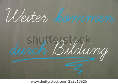 Chalkboard with the german words Next come through education / Education - stock photo