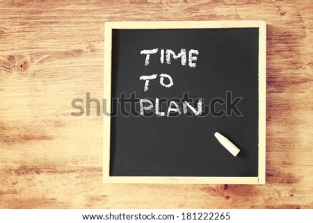 chalkboard with the phrase time to plan written on it. room for text. - stock photo