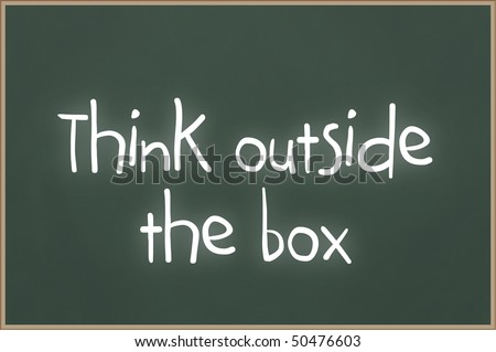 Chalkboard with wooden frame and the text think outside the box - stock photo