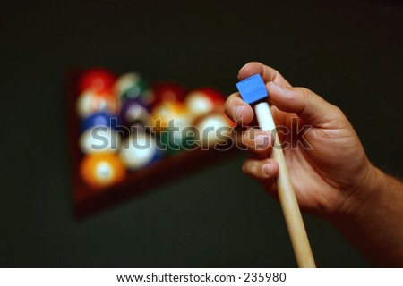 Chalking cue stick - stock photo