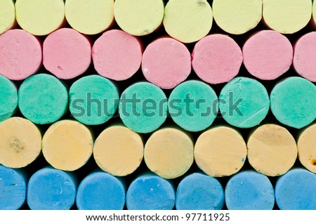 Chalks color background close-up front view. - stock photo