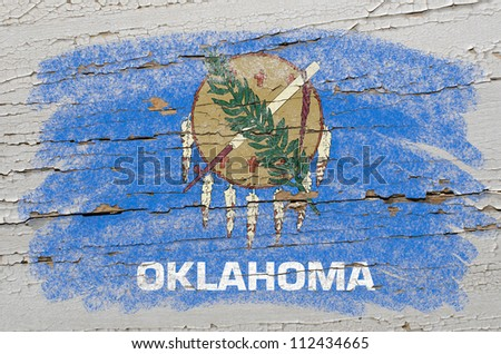 Chalky american state of oklahoma flag precisely painted with color chalk on grunge wooden texture - stock photo