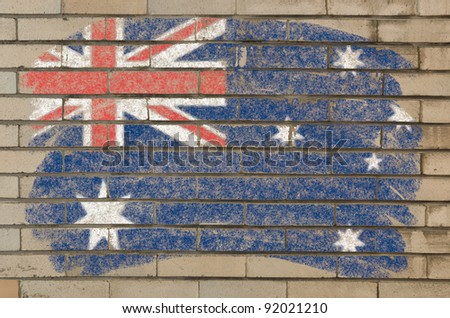 Chalky  australian flag painted with color chalk on grunge old brick wall - stock photo