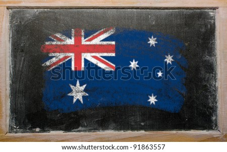 Chalky australian flag painted with color chalk on old blackboard - stock photo