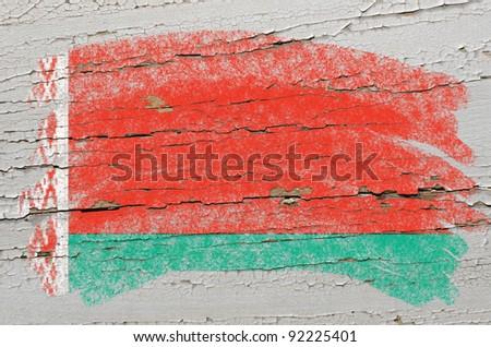 Chalky belarussian flag painted with color chalk on grunge wooden texture - stock photo