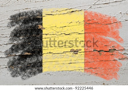 Chalky belgian flag painted with color chalk on grunge wooden texture - stock photo
