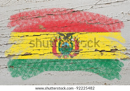 Chalky bolivian flag painted with color chalk on grunge wooden texture - stock photo