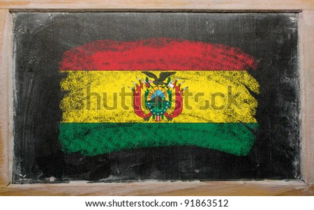 Chalky bolivian flag painted with color chalk on old blackboard - stock photo