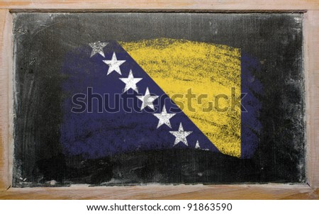 Chalky bosnia and herzegovina flag painted with color chalk on old blackboard - stock photo