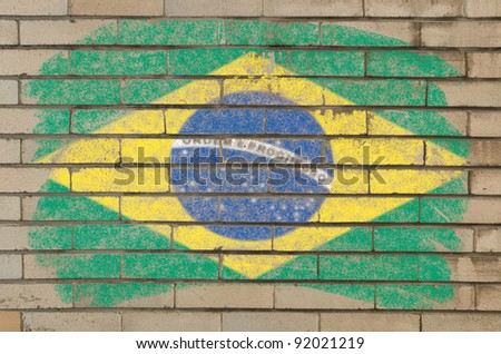 Chalky brazilian flag painted with color chalk on grunge old brick wall - stock photo