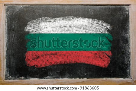Chalky bulgarian flag painted with color chalk on old blackboard - stock photo