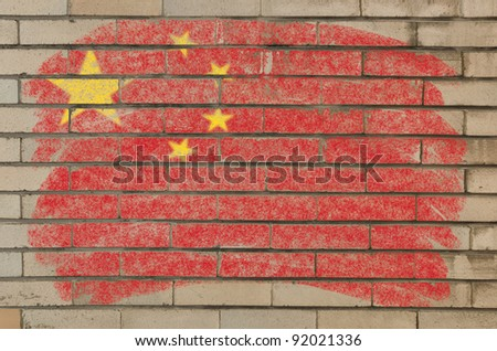 Chalky chinese flag painted with color chalk on grunge old brick wall - stock photo