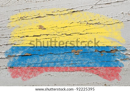 Chalky columbian flag painted with color chalk on grunge wooden texture - stock photo