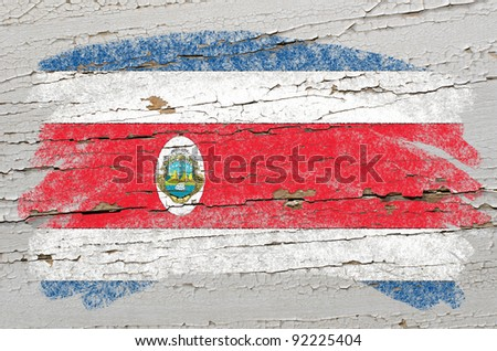 Chalky costa rica flag painted with color chalk on grunge wooden texture - stock photo