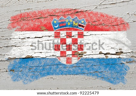 Chalky  croatian flag painted with color chalk on grunge wooden texture - stock photo