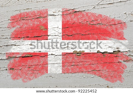 Chalky danish flag painted with color chalk on grunge wooden texture - stock photo