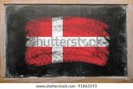 Chalky danish flag painted with color chalk on old blackboard - stock photo