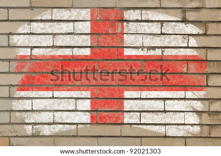 Chalky english flag painted with color chalk on grunge old brick wall
