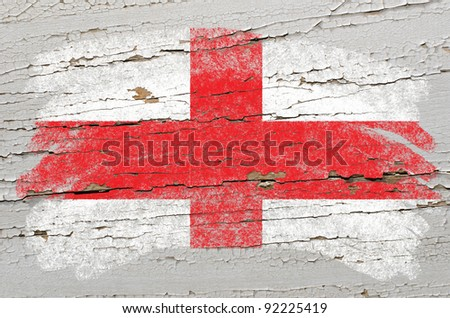 Chalky english flag painted with color chalk on grunge wooden texture