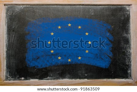 Chalky european union flag painted with color chalk on old blackboard - stock photo