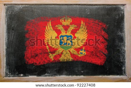 Chalky  flag painted with color chalk on old blackboard - stock photo