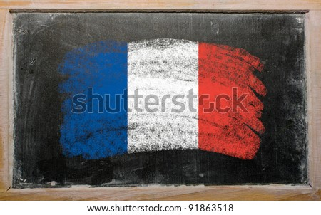 Chalky french flag painted with color chalk on old blackboard - stock photo
