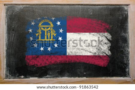 Chalky georgian flag painted with color chalk on old blackboard - stock photo