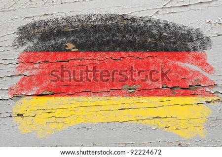 Chalky german flag painted with color chalk on grunge wooden texture - stock photo