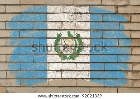 Chalky guatemalan flag painted with color chalk on grunge old brick wall - stock photo