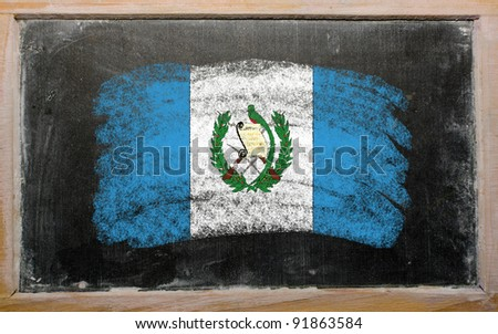 Chalky guatemalan flag painted with color chalk on old blackboard - stock photo