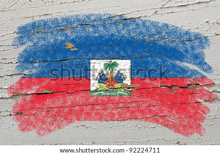Chalky haitian flag painted with color chalk on grunge wooden texture - stock photo