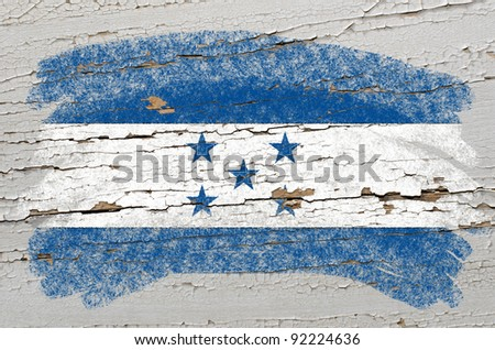 Chalky honduras flag painted with color chalk on grunge wooden texture - stock photo