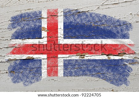 Chalky iceland flag painted with color chalk on grunge wooden texture - stock photo
