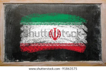 Chalky iran flag painted with color chalk on old blackboard - stock photo