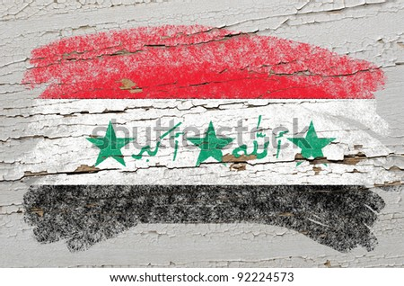Chalky iraq flag painted with color chalk on grunge wooden texture - stock photo