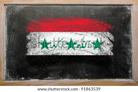 Chalky iraq flag painted with color chalk on old blackboard - stock photo